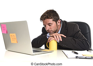 young tired and wasted businessman working in stress at...