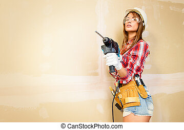 sexy construction worker - Attractive young woman doing...