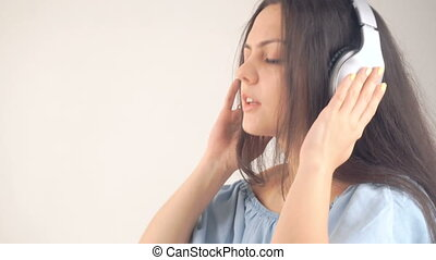 woman in headphones listening music - pretty young woman in...