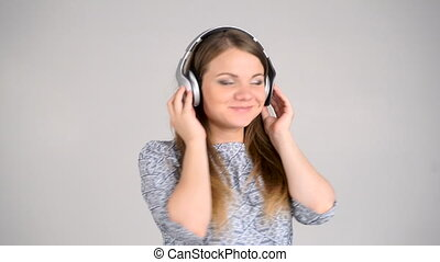 woman with headphones listen to the music - Beautiful woman...