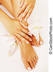 manicure pedicure with flower lily close up isolated on...