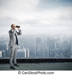 Businessman looking to the future - Businessman looks at the...