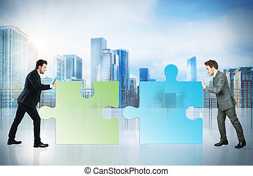Business partner - Businessmen push a pieces of puzzle fit...