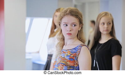 Handsome young girls take part in rehearsal in model school....