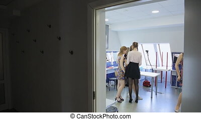 Group of girl prepares for going out in dressing room. They...