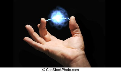 Energy - Video clip of a plasma ball arcing between thumb...