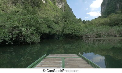 Boat sailing into karst cave. Trang An, Vietnam - Water tour...
