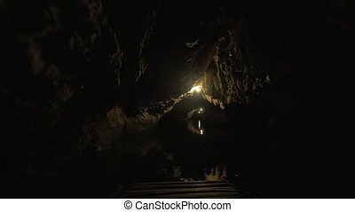 In the dark karst cave of Trang An, Vietnam - Exploring...