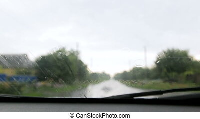 it is raining. rain drops falling on the glass of the car -...