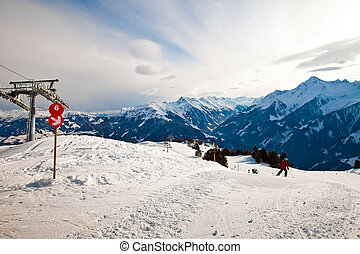 Red route sign on the ski resort in Alps mountains in...