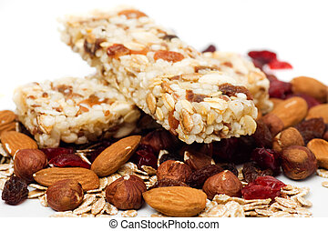 Granola bar on white background - Granola bar with dried...