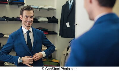 Successful Man wearing a jacket at boutique - Smiling...
