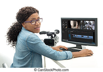 young African American woman video editor with computer and...