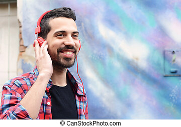Young man with headphones. - Portrait of young latin man...