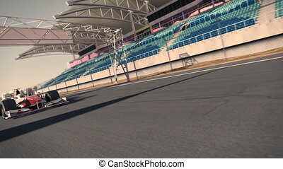 formula one race car speeding along the speedway - high...