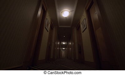 Seen the hotel corridor with closed doors of rooms and at...
