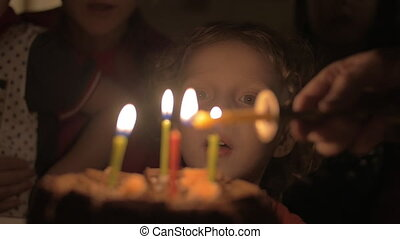 Little kid happy with his birthday cake - Slow motion of...