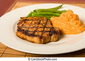 Grilled Pork Chop - Grilled pork chop served with green...