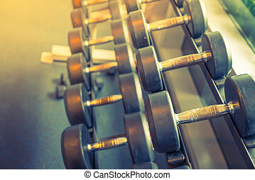 Sports dumbbells ( Filtered image processed vintage effect....