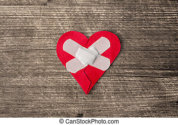 Wounded heart with plaster
