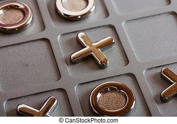 metal tic tac toe board - Close up of a metal tic tac toe...