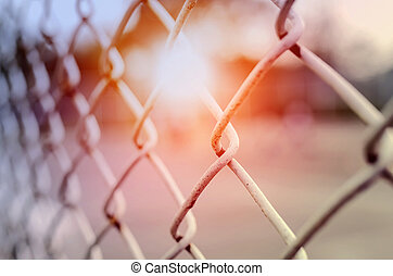 Rusty steel wire mesh fence under the sunlight,soft focus