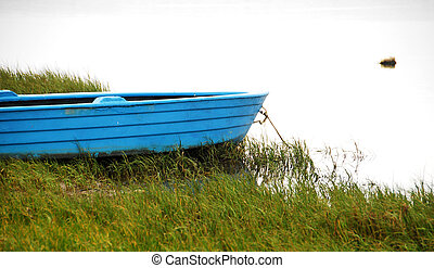 Blue Row Boat - Blue row boat on the shores of a tranquil...
