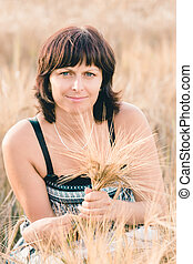 beauty woman in barley field - Middle aged beauty woman with...