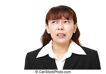 perplexed businesswoman - concept shot of Asian...