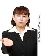 angry businesswoman requests something - concept shot of...