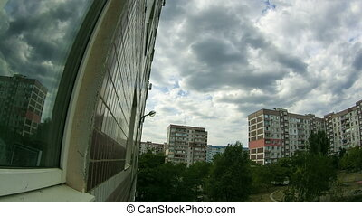 Clouds Moving Over The Multistorey Buildings. Time Lapse -...
