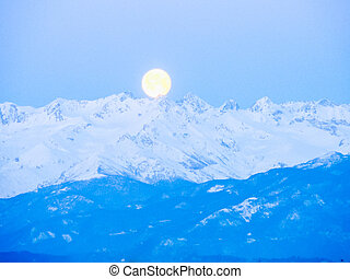 HDR Moon over the mountain - High dynamic range (HDR) The...