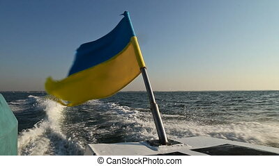 Ukrainian flag on a floating boat - Ukrainian flag on...