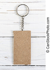Wooden key ring  on wooden background.