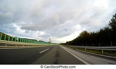 4k_Speeding car on the highway - Speeding car on the...