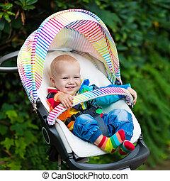 Baby boy in white stroller - Baby boy in white sweater...