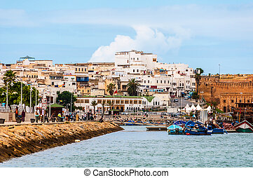 Rabat, Morocco - old buildings and embankment with fishing...
