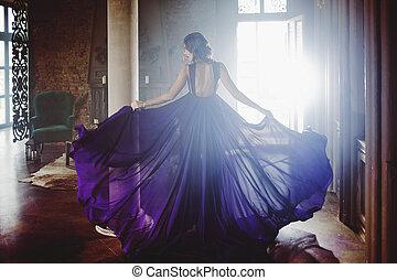Beauty Brunette model woman in evening purple dress....