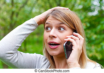 Bad news - Picture of a worried young woman on the phone