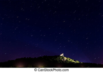 Nice night sky over the csatle in the village Szigliget of...