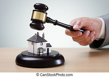 House auction - Bidding on a home, gavel and house concept...