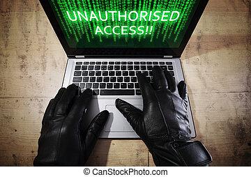 Hacker stealing data from a laptop - Computer hacker...
