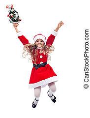 Little santa helper girl jumping - isolated