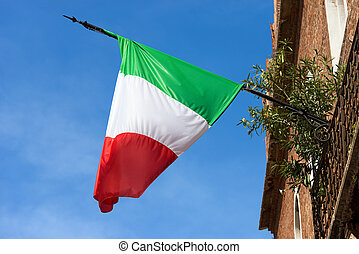 Italian Flag on Clear Blue Sky in Verona