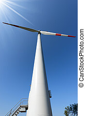 Wind Turbine with Sun Rays - White and red wind turbine with...