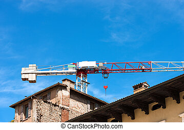 Construction Site with Red and White Crane - Detail of a...