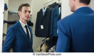 Man in a new suit at clothing store