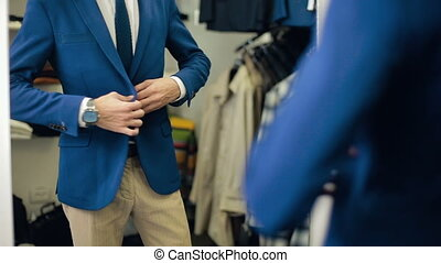 Handsome Man wearing suit at clothing store