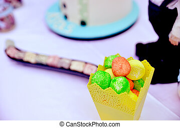variety of candies in a yellow paper bag - picture of a...