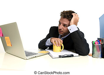 exhausted businessman suffering stress at office computer...